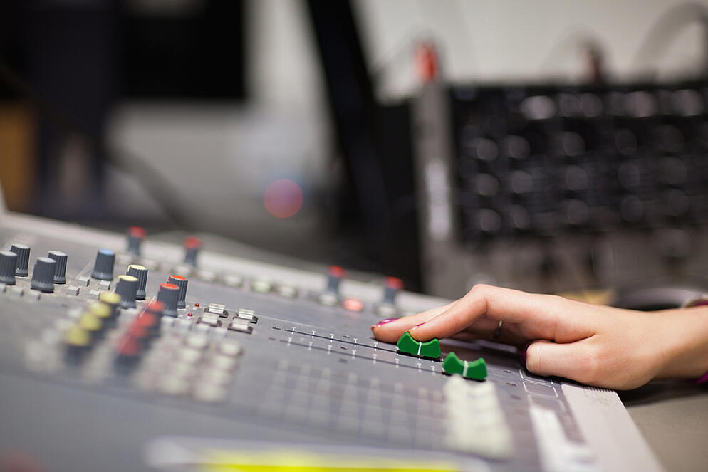 Hand setting the sound in a studio